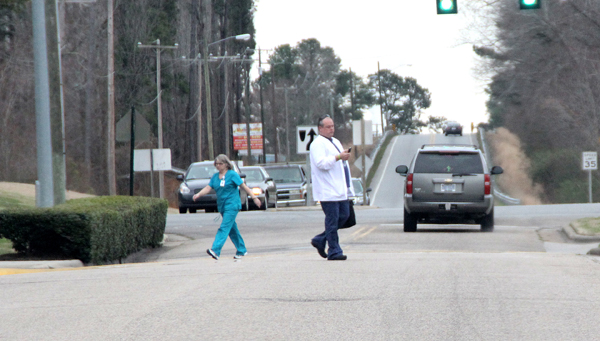 Two employees of Vidant Roanoke-Chowan Hospital cross Memorial Drive near the intersection of Academy Street. Hospital and town officials are coordinating their efforts to promote pedestrian safety in this area by installing crosswalks and signage. Staff Photo by Cal Bryant