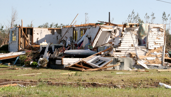 Severe weather can strike anywhere at any time, as evident in this photo taken on the morning after twin tornadoes cut a swath of death and destruction through Bertie and Hertford counties on April 16, 2011. This home was one of many that were damaged on Morris Ford Road near Colerain. File Photo by Cal Bryant