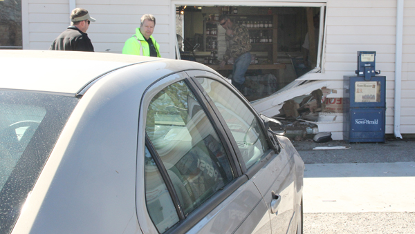 The driver of the vehicle shown in the foreground was responsible for accidently driving through the wall of Godwin's Country Meats on Wednesday morning. Staff Photo by Cal Bryant