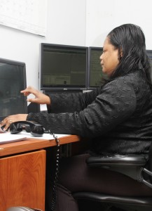 Dispatcher Felicia Gaston works inside the telecommunications room at the Ahoskie Police Department. If a state grant gains approval, APD's law enforcement communications will consolidate with those at the Murfreesboro Police Department and Hertford County Sheriff's Office at an E-911 Dispatch Center to be built near Winton. Staff Photo by Cal Bryant
