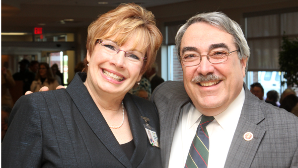 Kim Schwartz, CEO of Roanoke-Chowan Community Health Center, poses with U.S. Congressman G.K. Butterfield just prior to the start of Thursday's formal grand opening of Ahoskie Comprehensive Care. Staff Photo by Cal Bryant