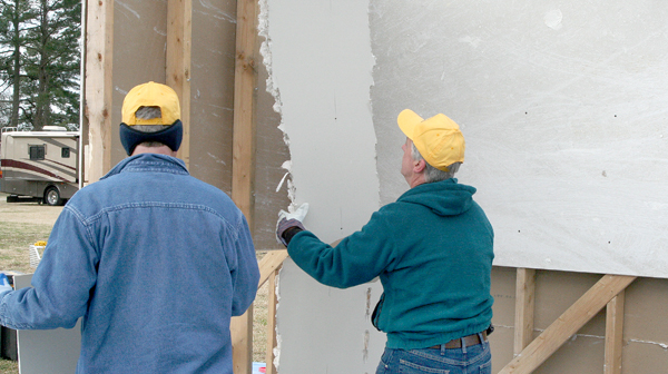 Volunteers with the NC Baptist Men's organization learn the proper technique in removing drywall damaged during a disaster. Staff Photo by Amanda VanDerBroek