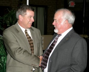 Chris Powell (left) chats with Tommy Oliver during one of his recent trips home to Ahoskie. File Photo by Cal Bryant