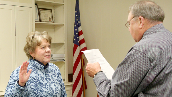 Margaret Burgwyn accepts the oath of office as a Woodland Town Commissioner from Mayor James Ellis Garris. She was appointed to fill an unexpired term. Staff Photo by Amanda VanDerBroek