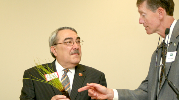 Congressman G.K. Butterfield (left) accepts a Longleaf Pine seedling from Peter Stangel, Senior Vice President for the US Endowment for Forestry and Communities. Staff Photo by Amanda VanDerBroek
