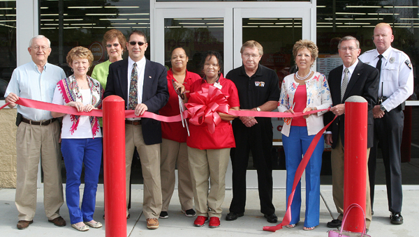 From left, Willie G. Simmons, Nancy Jenkins, Judy Collier, Brian Bolton, Cassandra Artis, Rita Nickols, Frank Will, Gail Wade, Joe Barrett and Joe Burgess took part in the ribbon cutting ceremony on Saturday to officially open Family Dollar in Conway. Staff Photo by Amanda VanDerBroek