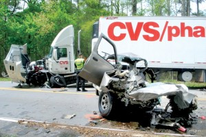 Don Evans, the driver of the pickup truck in the foreground, was killed during a Friday collision with the 18-wheeler shown in the background. Photo by Lance Martin