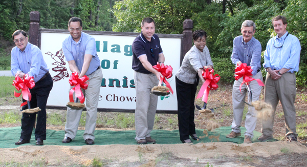 Taking part in last week's groundbreaking for the Tunis Wastewater Collection System project were, from left, Hertford County Commissioners Johnnie Ray Farmer and Bill Mitchell, engineer Slade Harvin, Hertford County Manager Loria Williams, Hertford County Public Works Director Mike Bradley, and Rick Williford, owner of Sunland Builders, the project's general contractor. Staff Photo by Cal Bryant