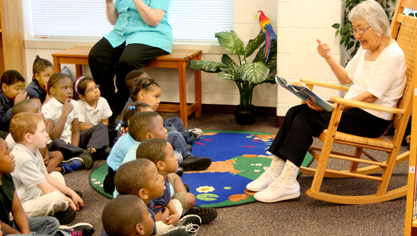 Sachiko Cannon reads Japanese folklore to a group of Kindergarten students at Central Elementary School in Jackson. She is the grandmother of Hollie Cannon, a teacher at the school. Staff Photo by Amanda VanDerBroek
