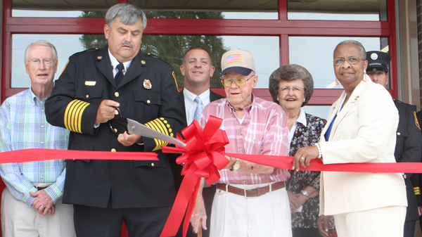 Ahoskie Fire Chief Ken Dilday cuts the ribbon to formally open the town's new fire station located on Dr. Martin Luther King Jr. Drive. Joining in on the Monday morning ceremony were, from left, Ahoskie Councilman Malcolm Copeland, Mayor Brien Lassiter, retired firefighter Bryant Norville, Councilwoman Elaine Myers and NC House Representative Annie Mobley. Staff Photo by Cal Bryant
