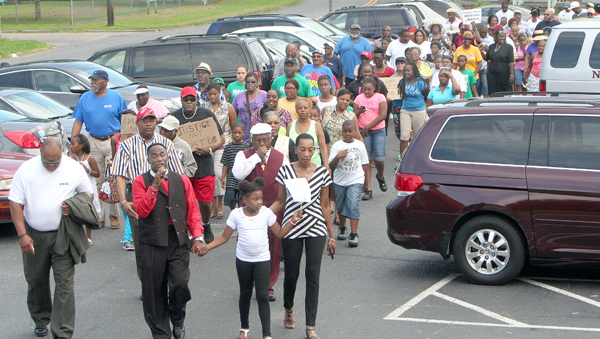 "A crowd of more than 150 participated in a ""Memorial March"" at New Ahoskie Baptist Church Sunday in solidarity and remembrance of slain Florida teen Trayvon Martin. Staff Photo by Gene Motley"