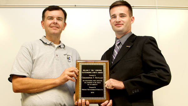 """Chris Buffaloe (right), Captain of Conway-Severn Rescue, receives the William F. """"Bill"""" Osborne Outstanding Chief Award from Paul Nowell. Staff Photo by Cal Bryant"""