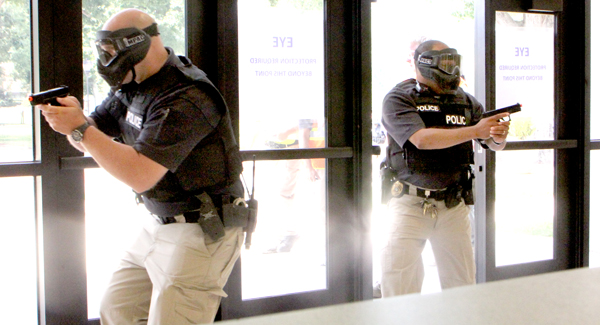 The first wave of police officers enter Marks Hall in search of a shooter during the Aug. 9  drill on the campus of Chowan University. Staff Photo by Cal Bryant