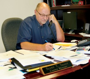 New Bertie County Manager Scott Sauer is shown working this past week in his Windsor office. Sauer comes to Bertie after serving as county manager in Harnett County for four years. Staff Photo by Gene Motley