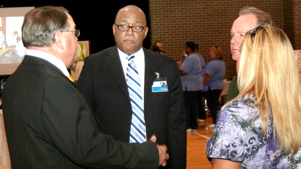 Dr. Michael Elam (second from left) was the center of attention on Tuesday during a reception held in his honor as the new president of Roanoke-Chowan Community College. Staff Photo by Gene Motley