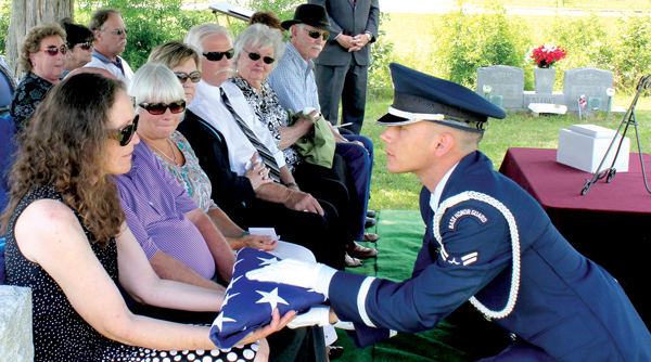 Lisa Renee Modlin, the daughter of the late Walker Randolph Modlin, accepts the American Flag from a member of an honor guard from Langley (VA) Air Force Base at the conclusion of a graveside service held in June at the Ahoskie Cemetery. Contributed Photo