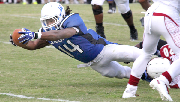 Chowan's Anthony Clanton finishes off a 12-yard run by diving into the endzone for the Hawks first TD vs. Shaw. Staff Photo by Cal Bryant
