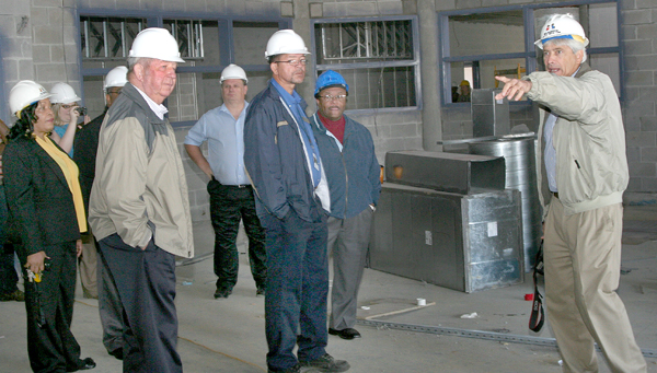 Jim Hite (right), architect of the new Bertie High School, points to a feature of the facility during Tuesday's tour. Bertie officials taking part in the tour included (foreground) Superintendent Elaine White, Commissioner J. Wallace Perry, Maintenance Supervisor Mathew Bond, and Commissioner Charles Smith. Staff Photo by Gene Motley