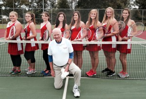 Coach Jake Campbell poses with his Northeast Academy tennis team (L-R): Brittany Byers, Casey Newsome, Tracy Clark, Mollie Cocke, Caitlin Foster, Nicole Burke, Robyn Barnes, and Lauren Flythe. The Eagles are 13-3 on the season. Contributed Photo