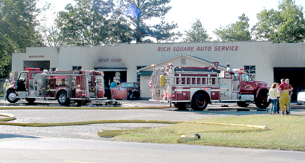 Firefighters from Rich Square, Woodland and Lasker responded to Friday morning's blaze at Rich Square Auto Service. Staff Photo by Judy Farmer