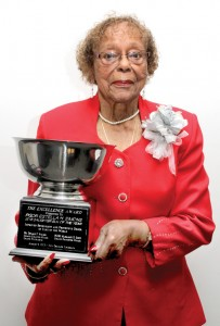 Estella Simons proudly displays the Elk of the Year Award she received at the 2013 Grand Lodge Convention of the IBPO of Elks of the World held in New Orleans. Staff Photo by Cal Bryant