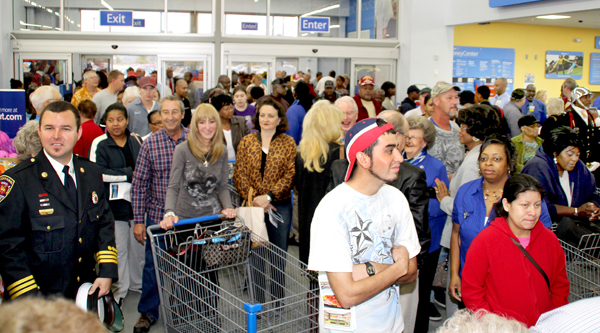 Wednesday morning's crowd at the new Ahoskie Walmart Super Center patiently waits to shop until store manager Nnea Rapu and Marshall Cherry, President of the Ahoskie Chamber of Commerce Board of Directors, cut the ribbon to formally open the new store. Staff Photo by Cal Bryant