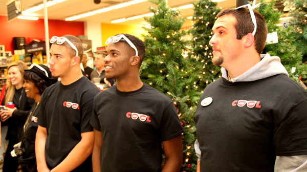 """Ace Hardware employees listen as their store was praised during a ceremony held Tuesday that deemed them to work for the """"Coolest Store on the Planet."""" Staff Photo by Cal Bryant"""