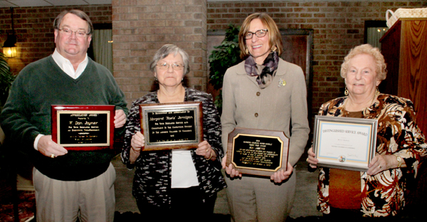 The annual Ahoskie Chamber of Commerce Banquet recognized several individuals for their outstanding achievements within the local community. Earning those honors were, from left, Dan Joyner, Rosie Jernigan, Sue Lassiter and Betty Rawls. Staff Photo by Cal Bryant
