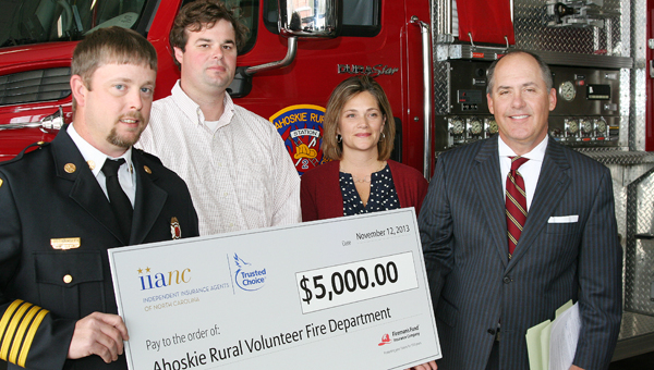 John Bradley (left), deputy chief of the Ahoskie Rural Volunteer Fire Department, accepts the $5,000 grant check from the Independent Insurance Agents of North Carolina (IIANC) and Fireman's Fund Insurance given to the department. Also on hand were, from left, Walt Pierce of Boyette & Robertson Agency of Ahoskie, Kellie Boone of the Fireman's Fund, and Kelley Erstine, CEO of IIANC. Staff Photo by Gene Motley