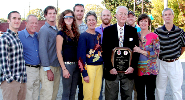 Dr. John H. Stanley is surrounded by his family – from left, Davis, Stevie, Arch, London, Brodie, Gen, John, Hunter, Dixie and Paul Harrell – at an Appreciation Day held in his honor on Nov. 3 in Woodland. Photo by Danny Bowman