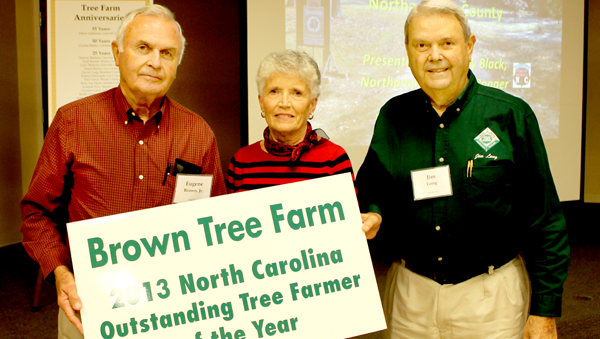 Eugene and Opal Brown are shown receiving the 2013 North Carolina Tree Farmers of the Year Award from Jim Long (right) of the North Carolina Forestry Association. Contributed Photo by NC Forest Service – Northampton County