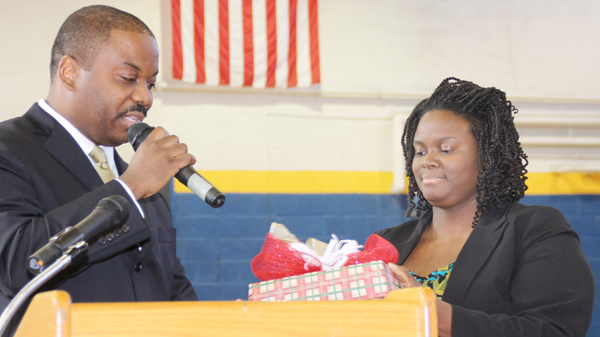 Rhonda Holmes accepts a gift from Dr. Eric Bracy, Superintendent of Northampton County Public Schools, after she was named as the North Central Region Teacher of the Year, now becoming one of the nine finalists for the statewide honor. Staff Photo by Cal Bryant