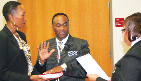 New Ahoskie Baptist Church pastor, Rev. C. David Stackhouse (center), elected last month as the new representative of Ward-B on the Ahoskie Town Council, is sworn in Tuesday by Town Clerk Joleatha Chestnutt as his wife, Renee Stackhouse, holds the Bible. Staff Photo by Gene Motley