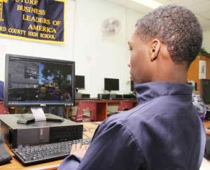 """Hertford County High School junior Derek Burke maneuver his """"avatar"""" into virtual university classrooms where he will study and earn college credits, part of the Rural Innovative Schools program now in its first year at HCHS. Staff Photo by Cal Bryant"""