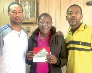 Lorraine Sanders-Ford holds an envelope containing five, $100 bills as donated by Ahoskie businessman Howard Hunter III (left). Shown at right is F. Garry Lewter. Contributed Photo
