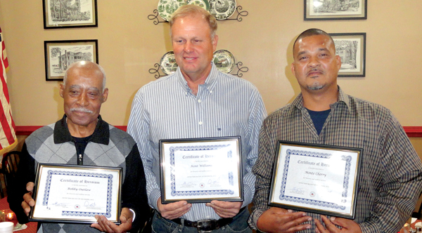 From left, Bobby Outlaw, Kent Williams and Monte Cherry hold the Certificates for Heroism awarded to the trio for actions they took on July 11 to save a passenger of a burning car at an accident scene on US 13 near Powellsville. Contributed Photo
