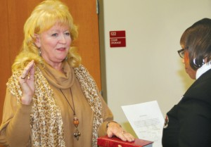 Linda Blackburn (left) is sworn into office as Ahoskie Town Council Member-At-Large during a ceremony prior to Tuesday's council meeting. Blackburn, a former Mayor of Ahoskie, was also selected by her fellow council members as Mayor Pro Tem. Staff Photo by Gene Motley