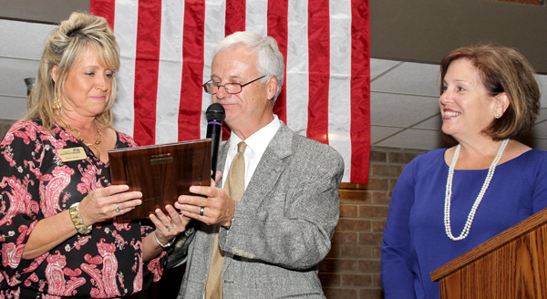 Teresa Jenkins (left) earned the Chamber Person of the Year Award during the 71st annual Ahoskie Chamber of Commerce Banquet held Tuesday night at the Ahoskie Inn. Shown making the presentation is Chamber Vice President Joe Murray with Executive VP Amy Braswell at right. Staff Photo by Cal Bryant