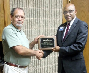 Dr. Michael Elam (right), President of Roanoke-Chowan Community College, receives the Roanoke-Chowan News-Herald Front Page Award from RCNH Editor Cal Bryant. Contributed Photo by Dan Joyner