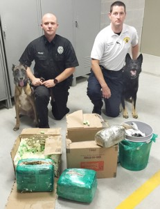 Murfreesboro Police Sgt. David Griffith (left) and K-9 'Jagar' joined with Hertford County Sheriff's Investigator Tom Helms and K-9 'Zeus' to assist in the recent interception of 28 pounds of marijuana. Photo contributed by Murfreesboro PD