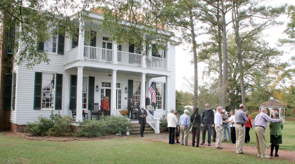 A small portion of the crowd attending the Nov. 9 event gathers near the main entrance of the Wiggins-Savage House, a plantation home saved from near ruin by a New Jersey couple. Staff Photo by Cal Bryant