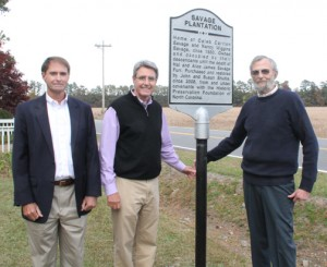 From left, Ren Williamson, Carlton Williamson and John Shultis pose by the highway marker erected at the Savage Plantation. Staff Photo by Cal Bryant