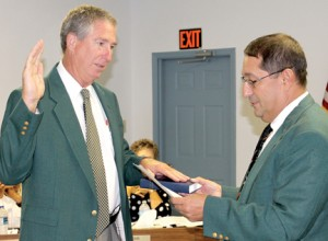 Stewart Woodard (left) accepts the oath of office as a member of the Conway Board of Commissioner from town Mayor Brian Bolton. Contributed Photo