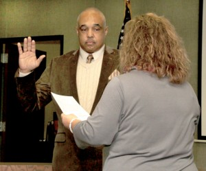 Hertford County Commissioner Curtis Freeman receives his oath of office on Monday morning from Shelia Matthews, Clerk to the Board. Staff Photo by Cal Bryant
