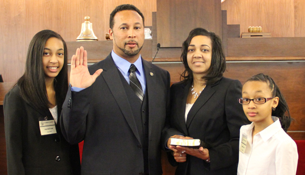 District 5 State House Representative Howard Hunter III took the oath of office on Wednesday in Raleigh, joined by his daughters, Zaria (left) and Kayla (right), while his wife,   Dr. Wanda Hunter, held the Bible, the same one used by his late father (Howard Hunter Jr.) to take his oath back in 2003. Contributed Photo
