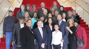 """Howard Hunter III (front row, third from right) stands with his family as well as a group of Hertford County citizens who made the """"icy"""" trip to Raleigh on Wednesday to witness Hunter being sworn in as the District 5 member of the North Carolina House of Representatives. Hunter spent 10 years as a Hertford County Commissioner before winning the House seat in November of last year. Contributed Photo"""