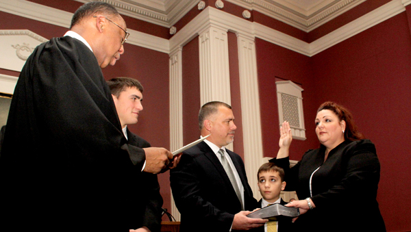 Valerie Asbell accepts the oath of office as District Attorney from Resident Superior Court Judge Cy A. Grant Sr. (left) on Jan. 1 in the Northampton County Courthouse. Joining her are family members, from left, stepson Cole, husband Jimmy, and son Ethan. Staff Photo by Cal Bryant