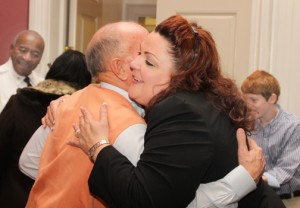 Asbell hugs a supporter following the ceremony. Staff Photo by Cal Bryant