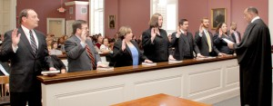 Judge Grant (right) administers the oath of office Asbell's assistant District Attorneys, a group that includes Derek Brown, Kim Gourrier, Julie Weissman, Charlie Cole, Charles Kinsey, Keith Werner, Norlan Graves, Kanter Morris and Justin Wier.
