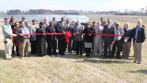Roanoke Electric Cooperative officials are joined by local and regional dignitaries as they cut the ceremonial ribbon to formally open the Community Solar Farm located adjacent to the REC headquarters. Staff Photo by Cal Bryant